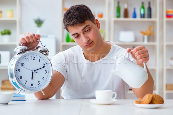 человека будильник падение спящий завтрак часы Сток-фото © Elnur