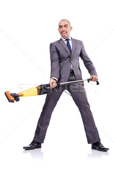 Stock photo: Businessman doing vacuum cleaning on white