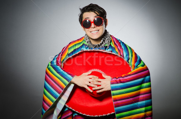 Man in vivid mexican poncho against gray Stock photo © Elnur