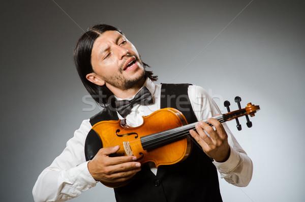 Uomo giocare violino musicale arte divertente Foto d'archivio © Elnur