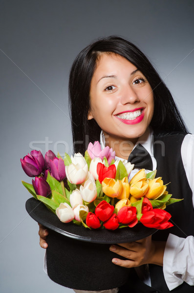 Woman with flowers in hat Stock photo © Elnur