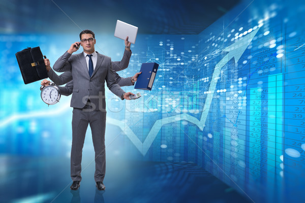 The young businessman in multitasking concept Stock photo © Elnur