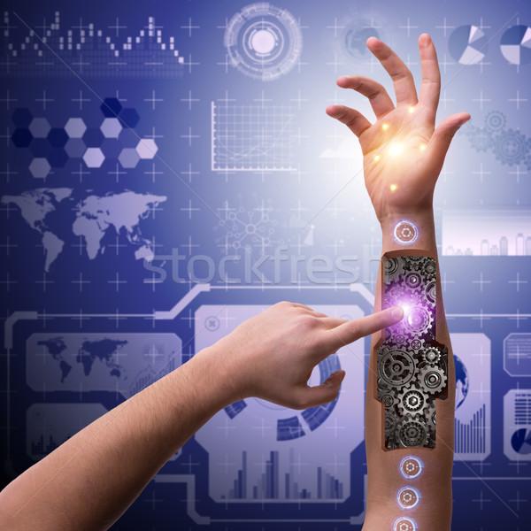 Robotic hand pressing button in futuristic concept Stock photo © Elnur
