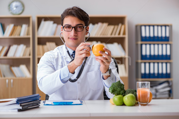 Scientist studying nutrition in various food Stock photo © Elnur