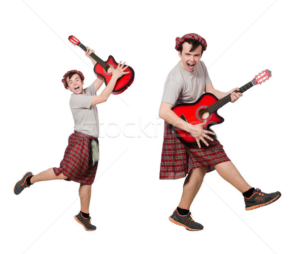 The scotsman playing guitar isolated on white Stock photo © Elnur