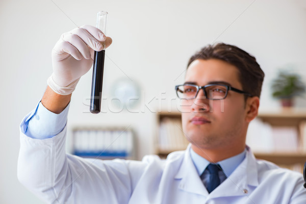 Chemical engineer working on oil samples in lab Stock photo © Elnur