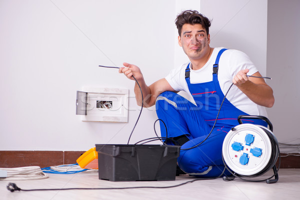 Funny Man doing electrical repairs at home Stock photo © Elnur