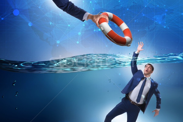 Businessman being saved from drowning Stock photo © Elnur