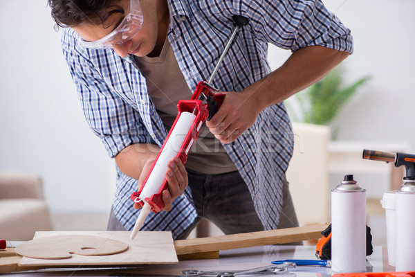 Young man in woodworking hobby concept Stock photo © Elnur