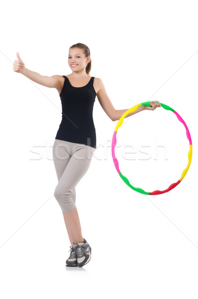 Woman doing exercises with hula hoop Stock photo © Elnur
