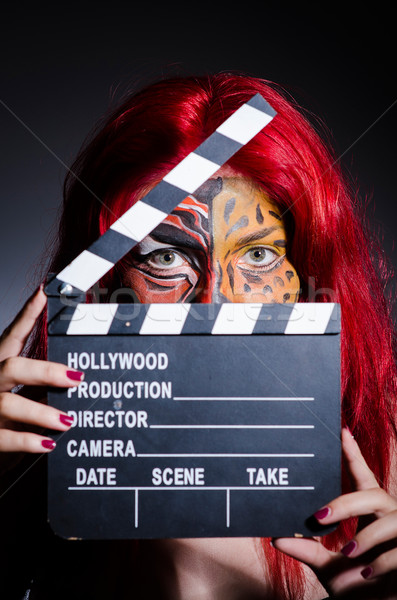 Woman with facepaint and movie clapper Stock photo © Elnur