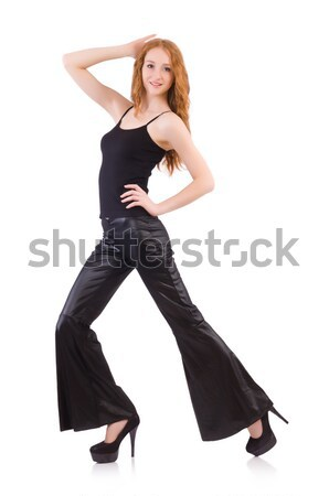 Redhead woman in black bell bottom pants on white Stock photo © Elnur