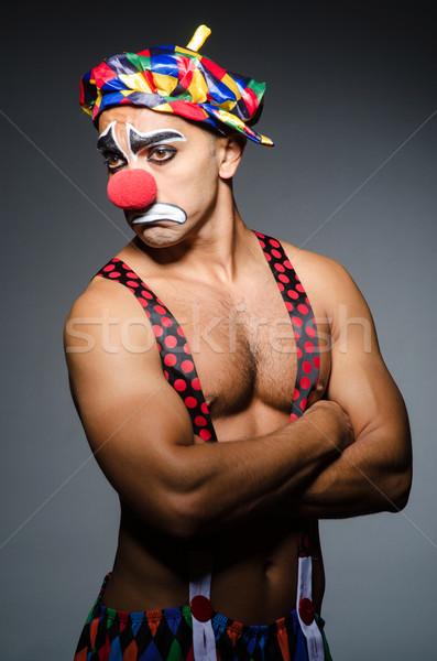 Sad clown against dark background Stock photo © Elnur