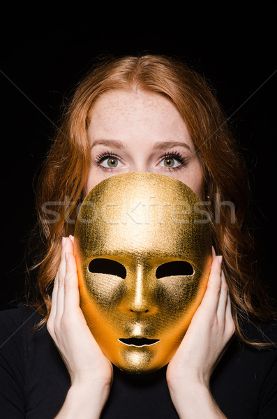 Redhead woman iwith mask in hypocrisy consept against black  bac Stock photo © Elnur