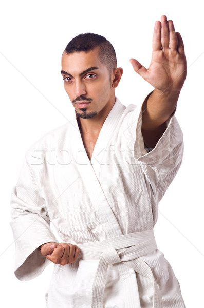 Stock photo: Karate fighter isolated on the white