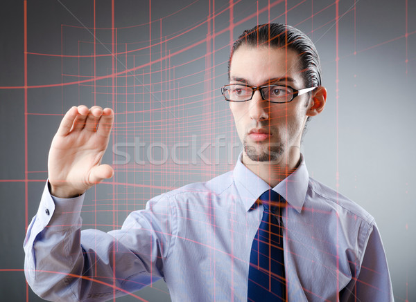 Businessman pressing virtual buttons in futuristic concept Stock photo © Elnur