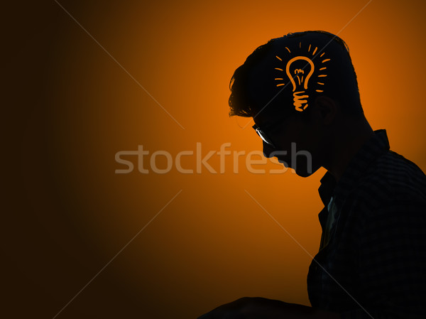 Bright idea concept with light bulb and man Stock photo © Elnur