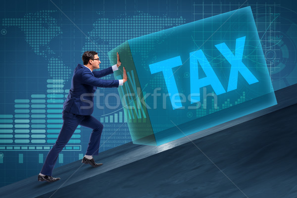 The businessman in high taxes concept Stock photo © Elnur