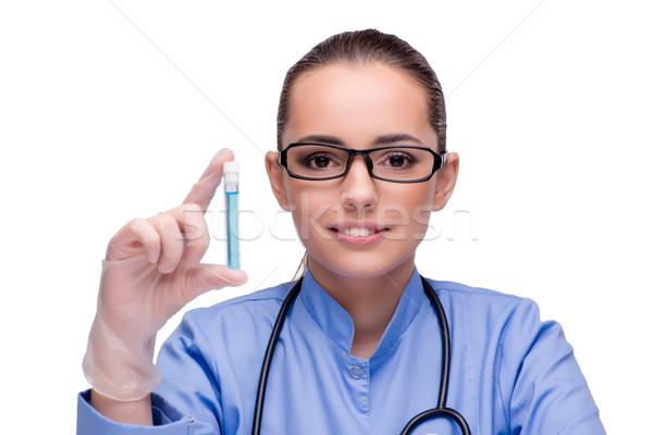 Doctor holding tube isolated on white Stock photo © Elnur