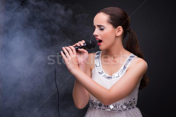 Joven cantando karaoke club mujer nina Foto stock © Elnur