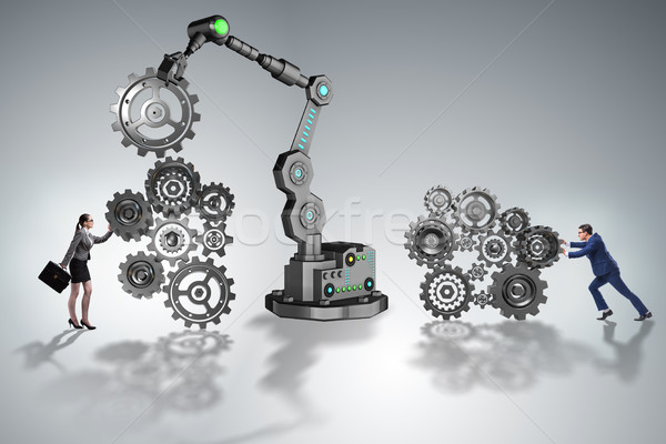 The businesspeople with cogwheel and robotic arm Stock photo © Elnur