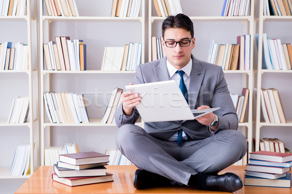 Stock photo: Businessman student in lotus position meditating with a laptop i