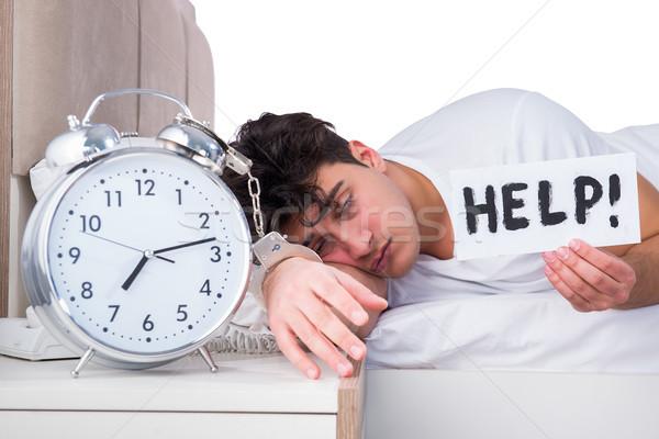 Homem cama sofrimento insônia relógio ajudar Foto stock © Elnur