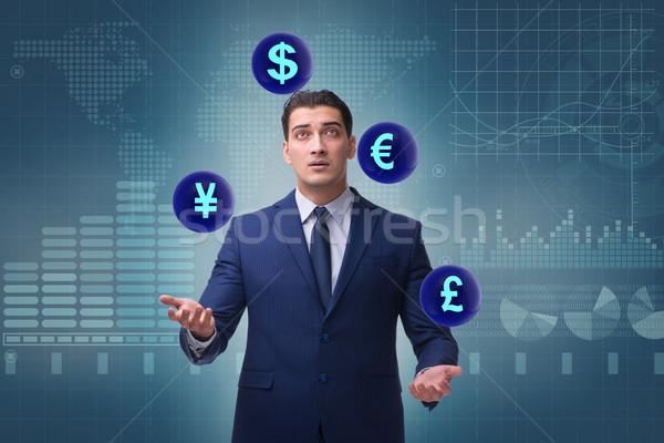 Businessman juggling between various currencies Stock photo © Elnur