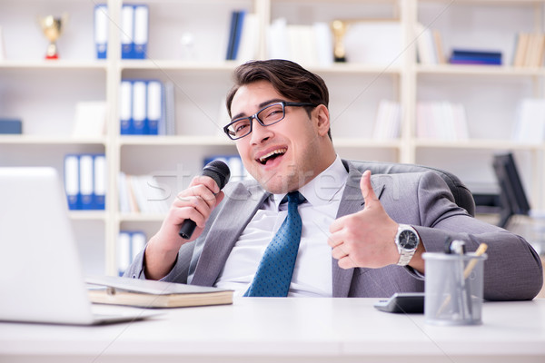 The businessman singing in the office Stock photo © Elnur