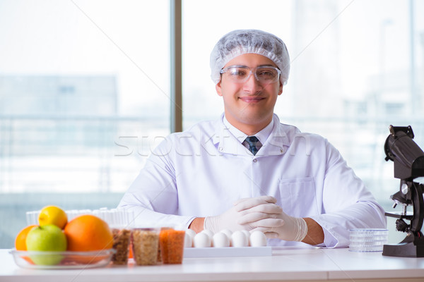 The nutrition expert testing food products in lab Stock photo © Elnur