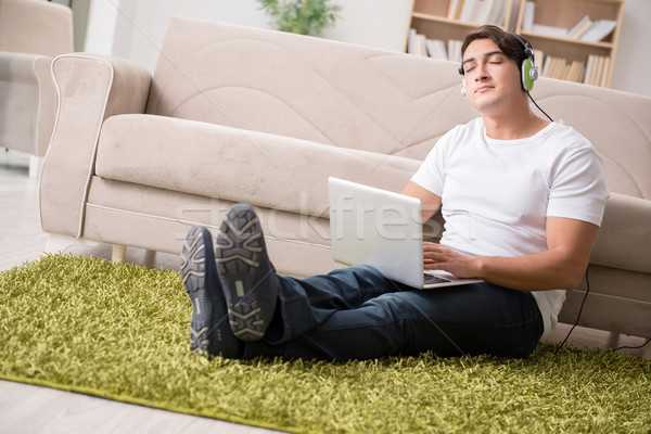 Freelancer working at home and listening to music Stock photo © Elnur