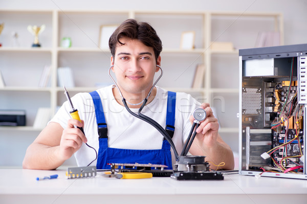 Computer hardware repair and fixing concept by experienced techn Stock photo © Elnur