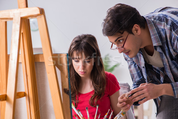Artist coaching student in painting class in studio Stock photo © Elnur