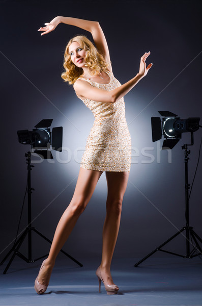 Young attractive woman in photo studio Stock photo © Elnur