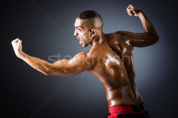 Boxer with red gloves in dark room Stock photo © Elnur