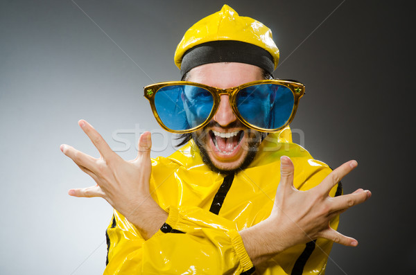 Man wearing yellow suit in funny concept Stock photo © Elnur