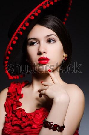 Woman portrait against dark background Stock photo © Elnur