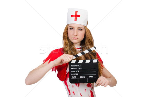 Woman doctor in bloody uniform with movie clapperboard Stock photo © Elnur