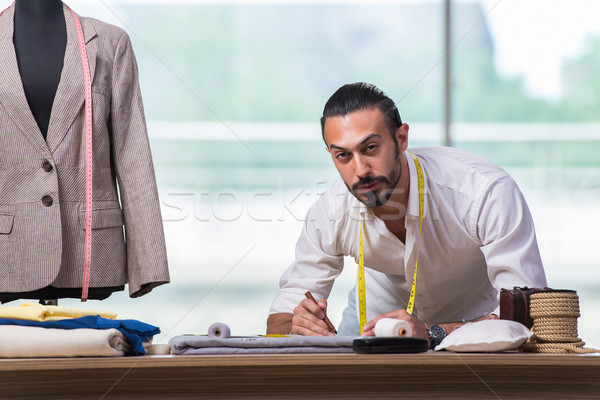 Stock photo: Young tailor working on new clothing design