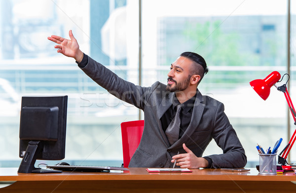 Businessman cheering saluting in the office Stock photo © Elnur