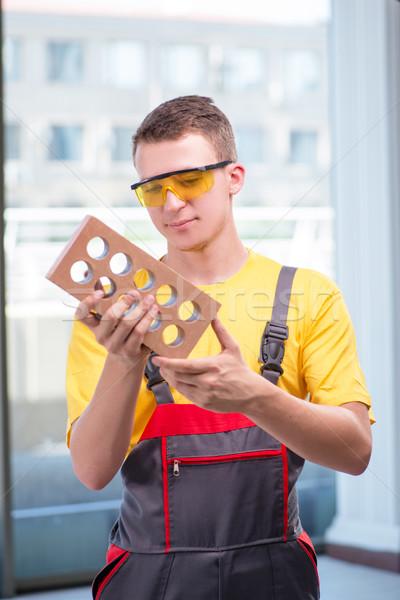 Jonge bouwvakker Geel business werk zakenman Stockfoto © Elnur
