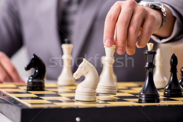 Young businessman playing chess in the office Stock photo © Elnur