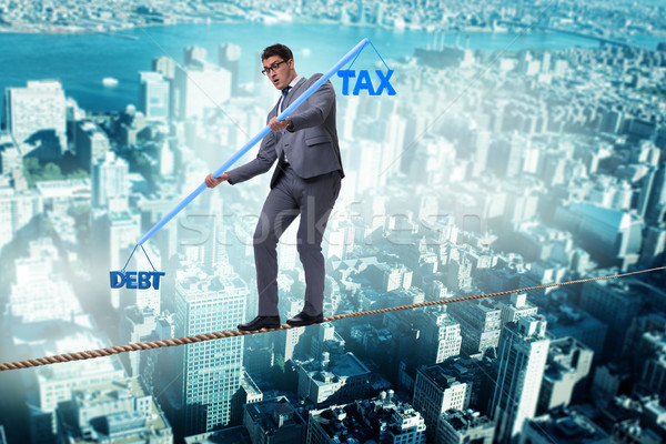 Businessman balancing between debt and tax Stock photo © Elnur