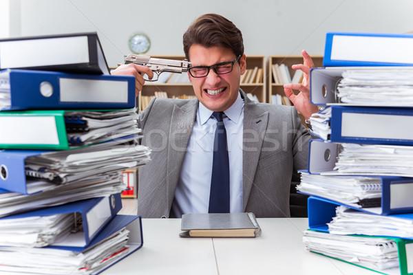 Businessman under stress due to excessive work Stock photo © Elnur