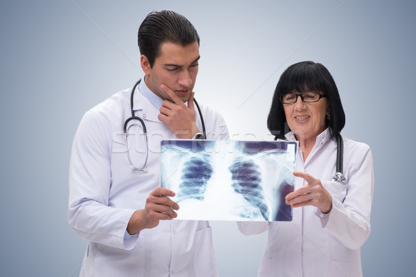 The two doctors looking at x-ray image Stock photo © Elnur
