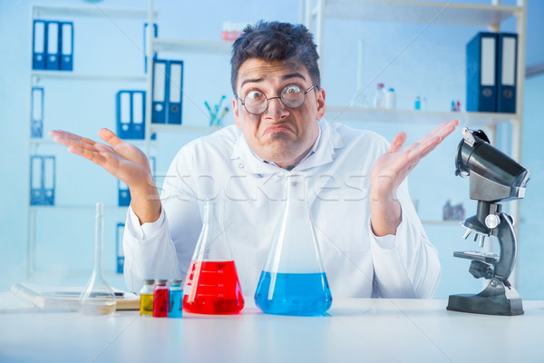 Funny mad chemist working in a laboratory Stock photo © Elnur