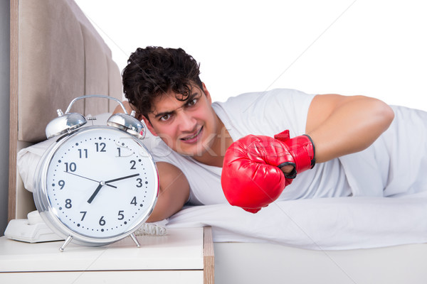 Homme lit souffrance insomnie horloge boîte Photo stock © Elnur