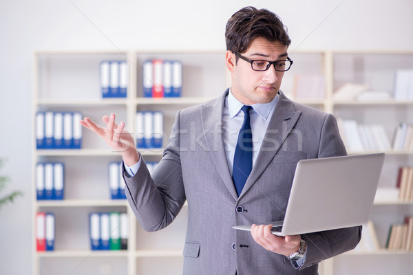 The businessman in the office working with laptop Stock photo © Elnur