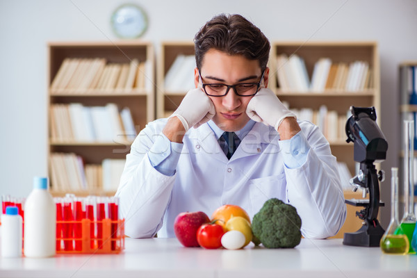 Man doctor checking the fruits and vegetables Stock photo © Elnur