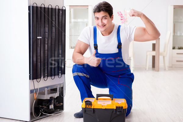 Repairman contractor repairing fridge in DIY concept Stock photo © Elnur